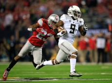 ARLINGTON, TX - JANUARY 12:  Running back Byron Marshall #9 of the Oregon Ducks scores runs the ball 70 yards after a catch to score a touchdown in the third quarter against the Ohio State Buckeyes during the College Football Playoff National Championship Game at AT&T Stadium on January 12, 2015 in Arlington, Texas.  (Photo by Jamie Squire/Getty Images)