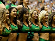 SAN ANTONIO, TX - DECEMBER 30:  Oregon Ducks cheerleaders perform during the Valero Alamo Bowl against the Texas Longhorns at the Alamodome on December 30, 2013 in San Antonio, Texas.  (Photo by Ronald Martinez/Getty Images)