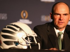 DALLAS, TX - JANUARY 11:  Head Coach Mark Helfrich of the Oregon Ducks speaks with the media in front of the College Football Playoff National Championship trophy during a Head Coaches press conference at the Renaissance Dallas Hotel on January 11, 2015 in Dallas, Texas.  (Photo by Ronald Martinez/Getty Images)