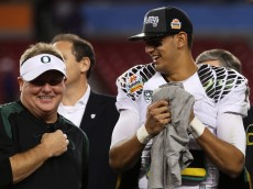GLENDALE, AZ - JANUARY 03:  Head coach Chip Kelly celebrates with Marcus Mariota #8 of the Oregon Ducks after their 35 to 17 win over the Kansas State Wildcats in the Tostitos Fiesta Bowl at University of Phoenix Stadium on January 3, 2013 in Glendale, Arizona.  (Photo by Stephen Dunn/Getty Images)