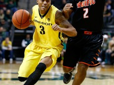 EUGENE, OR - NOVEMBER 29:  Joseph Young #3 of the Oregon Ducks drives against T.J. Wallace #2 of the Pacific Tigers on November 29, 2013 at Matthew Knight Arena in Eugene, Oregon.  (Photo by Jonathan Ferrey/Getty Images)