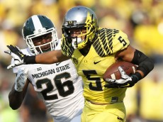 EUGENE, OR - SEPTEMBER 6: Devon Allen #5 of the Oregon Ducks heads toward the end zone on a 70-yard touchdown reception in the first half of the game against the Michigan State Spartans at Autzen Stadium on September 6, 2014 in Eugene, Oregon. (Photo by Joe Robbins/Getty Images)