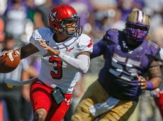 SEATTLE, WA - SEPTEMBER 06:  Quarterback Vernon Adams Jr. #3 of the Eastern Washington Eagles rushes against the Washington Huskies on September 6, 2014 at Husky Stadium in Seattle, Washington.  (Photo by Otto Greule Jr/Getty Images)