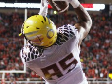 SALT LAKE CITY, UT - NOVEMBER 8:  Tight end Pharaoh Brown #85 of the Oregon Ducks catches a touchdown pass against the Utah Utes during the first half of an NCAA football game November 8, 2014 at Rice-Eccles Stadium in Salt Lake City, Utah. (Photo by George Frey/Getty Images)