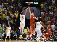 LAS VEGAS, NV - MARCH 13:  Joseph Young #3 of the Oregon Ducks shoots a game-winning 3-pointer against Jakob Poeltl #42 of the Utah Utes in a semifinal game of the Pac-12 Basketball Tournament at the MGM Grand Garden Arena on March 13, 2015 in Las Vegas, Nevada. Oregon won 67-64.  (Photo by Ethan Miller/Getty Images)