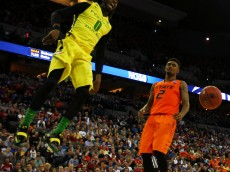 OMAHA, NE - MARCH 20:  Dwayne Benjamin #0 of the Oregon Ducks dunks over Le'Bryan Nash #2 of the Oklahoma State Cowboys in the second half during the second round of the 2015 NCAA Men's Basketball Tournament at the CenturyLink Center on March 20, 2015 in Omaha, Nebraska.  (Photo by Jamie Squire/Getty Images)