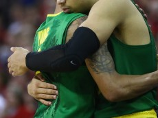 OMAHA, NE - MARCH 22:  (L-R) Joseph Young #3 of the Oregon Ducks hugs Dillon Brooks #23 after leaving the game against the Wisconsin Badgers during the third round of the 2015 NCAA Men's Basketball Tournament at the CenturyLink Center on March 22, 2015 in Omaha, Nebraska  (Photo by Ronald Martinez/Getty Images)