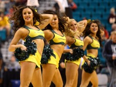 LAS VEGAS, NV - MARCH 12:  Oregon Ducks cheerleaders perform during a first-round game of the Pac-12 Basketball Tournament against the Oregon State Beavers at the MGM Grand Garden Arena on March 12, 2014 in Las Vegas, Nevada. Oregon won 88-74.  (Photo by Ethan Miller/Getty Images)