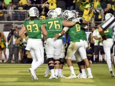 SANTA CLARA, CA - DECEMBER 05:  Johnny Mundt #83 of the Oregon Ducks, Jake Pisarcik #76 of the Oregon Ducks and Marcus Mariota #8 of the Oregon Ducks celebrate a third quarter touchdown against the Arizona Wildcats during the PAC-12 Championships at Levi's Stadium on December 5, 2014 in Santa Clara, California.  (Photo by Thearon W. Henderson/Getty Images)