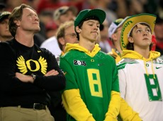 ARLINGTON, TX - JANUARY 12:  Oregon Ducks fans react during the College Football Playoff National Championship Game at AT&T Stadium on January 12, 2015 in Arlington, Texas.  (Photo by Jamie Squire/Getty Images)