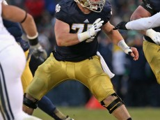 SOUTH BEND, IN - NOVEMBER 23: Matt Hegarty #77 of the Notre Dame Fighting Irish moves to block against the Brigham Young Cougars at Notre Dame Stadium on November 23, 2013 in South Bend, Indiana. Notre Dame defeated BYU 23-13. (Photo by Jonathan Daniel/Getty Images)
