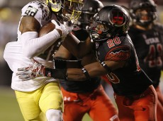 SALT LAKE CITY, UT - NOVEMBER 8:  wide receiver Dwayne Stanford #88 of the Oregon Ducks runs for a touchdown as defensive back Marcus Williams #20 of the Utah Utes tries to tackle him during the second half of an NCAA football game November 8, 2014 at Rice-Eccles Stadium in Salt Lake City, Utah. Oregon defeated Utah 51-27. (Photo by George Frey/Getty Images)