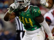 SANTA CLARA, CA - DECEMBER 05: DeForest Buckner #44 of the Oregon Ducks celebrates in front of fans during the first half of the PAC-12 Championships against the Arizona Wildcats at Levi's Stadium on December 5, 2014 in Santa Clara, California. (Photo by Brian Bahr/Getty Images)
