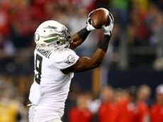 ARLINGTON, TX - JANUARY 12:  Running back Byron Marshall #9 of the Oregon Ducks catches a pass to score a 70 yard touchdown in the third quarter against the Ohio State Buckeyes during the College Football Playoff National Championship Game at AT&T Stadium on January 12, 2015 in Arlington, Texas.  (Photo by Ronald Martinez/Getty Images)