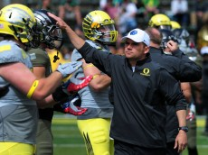 EUGENE, OR - MAY 3: Oregon Ducks head coach Mark Helfrich greets his players  before the Spring game at Autzen Stadium on May 3, 2014 in Eugene, Oregon. (Photo by Steve Dykes/Getty Images)