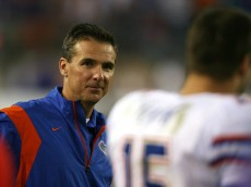 JACKSONVILLE, FL - NOVEMBER 01:  Head coach Urban Meyer smiles toward quarterback Tim Tebow #15 of the Florida Gators after a touchdown in the third quarter against the Georgia Bulldogs at Jacksonville Municipal Stadium on November 1, 2008 in Jacksonville, Florida. Florida defeated Georgia 49-10.  (Photo by Doug Benc/Getty Images)