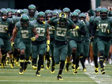 EUGENE, OR - OCTOBER 26:  The Oregon Ducks run onto the field before the game against of the UCLA Bruins on October 26, 2013 at the Autzen Stadium in Eugene, Oregon.  (Photo by Jonathan Ferrey/Getty Images)
