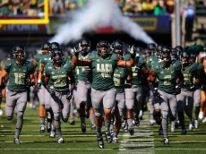 EUGENE, OR - SEPTEMBER 13:  Rodney Hardick #48 of the Oregon Ducks leads the team onto the field against the Wyoming Cowboys at Autzen Stadium on September 13, 2014  in Eugene, Oregon.  (Photo by Jonathan Ferrey/Getty Images)