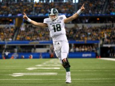 ARLINGTON, TX - JANUARY 01:  Connor Cook #18 of the Michigan State Spartans celebrates after the Spartans score a touchdown against the Baylor Bears during the first half of the Goodyear Cotton Bowl Classic at AT&T Stadium on January 1, 2015 in Arlington, Texas.  (Photo by Ronald Martinez/Getty Images)