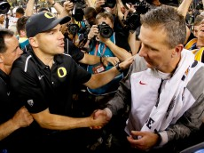 ARLINGTON, TX - JANUARY 12:  Head Coach Urban Meyer (R) of the Ohio State Buckeyes shakes hands with Head coach Mark Helfrich (L) of the Oregon Ducks after the College Football Playoff National Championship Game at AT&T Stadium on January 12, 2015 in Arlington, Texas. The Ohio State Buckeyes defeated the Oregon Ducks 42 to 20.  (Photo by Tom Pennington/Getty Images)