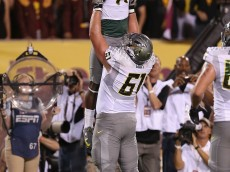 TEMPE, AZ - OCTOBER 18:  Wide receiver Bralon Addison #11 of the Oregon Ducks is hoisted up in the air by offensive linesman Nick Cody #61 after Addison scored a 6 yard touchdown reception against the Arizona State Sun Devils during the first quarter of the college football game at Sun Devil Stadium on October 18, 2012 in Tempe, Arizona.  (Photo by Christian Petersen/Getty Images)
