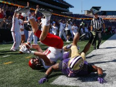 SEATTLE, WA - SEPTEMBER 06:  Wide receiver Cooper Kupp #10 of the Eastern Washington Eagles scores a touchdown against defensive back Kevin King #20 of the Washington Huskies on September 6, 2014 at Husky Stadium in Seattle, Washington.  (Photo by Otto Greule Jr/Getty Images)