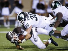 KALAMAZOO, MI - SEPTEMBER 4: Zach Terrell #11 of the Western Michigan Broncos is sacked by Riley Bullough #30 of the Michigan State Spartans in the second half at Waldo Stadium on September 4, 2015 in Kalamazoo, Michigan. The Spartans defeated the Broncos 37-24. (Photo by Joe Robbins/Getty Images)