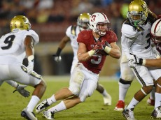 PALO ALTO, CA - OCTOBER 15:  Christian McCaffrey #5 of the Stanford Cardinal's rushes with the ball against the UCLA Bruins in the third quarter of an NCAA football game at Stanford Stadium on October 15, 2015 in Stanford, California.  (Photo by Thearon W. Henderson/Getty Images)