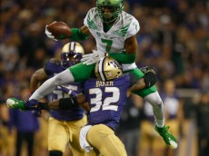 SEATTLE, WA - OCTOBER 17:  Wide receiver Darren Carrington #7 of the Oregon Ducks hurdles defensive back Budda Baker #32 of the Washington Huskies in the second half on October 17, 2015 at Husky Stadium in Seattle, Washington. The Ducks defeated the Huskies 26-20.  (Photo by Otto Greule Jr/Getty Images)