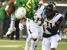 EUGENE, OR - NOVEMBER 07: Quarterback Vernon Adams Jr. #3 of the Oregon Ducks flips into the endzone for a touchdown during the second quarter of the game against the California Golden Bears at Autzen Stadium on November 7, 2015 in Eugene, Oregon.  (Photo by Steve Dykes/Getty Images)
