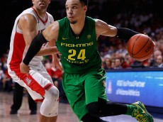 TUCSON, AZ - JANUARY 28:  Dillon Brooks #24 of the Oregon Ducks drives the ball past Ryan Anderson #12 of the Arizona Wildcats during the second half of the college basketball game at McKale Center on January 28, 2016 in Tucson, Arizona. The Ducks defeated the Wildcats 83-75.  (Photo by Christian Petersen/Getty Images)