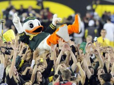 EUGENE, OR - OCTOBER 2: Puddles the Oregon Duck mascot is carried on the shoulders of fans on the feild of Autzen Stadium after the Oregon Ducks beat the Stanford Cardinal 52-31 at Autzen Stadium on October 2, 2010 in Eugene, Oregon. (Photo by Steve Dykes/Getty Images)