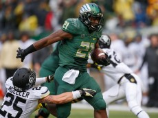 EUGENE, OR - NOVEMBER 22:  Running back Royce Freeman #21 of the Oregon Ducks rushes for a touchdown against Ryan Moeller #25 of the Colorado Buffaloes in the first quarter at Autzen Stadium on November 22, 2014 in Eugene, Oregon.  (Photo by Otto Greule Jr/Getty Images)