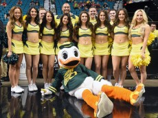 LAS VEGAS, NV - MARCH 12:  Oregon Ducks mascot The Duck poses with Oregon cheerleaders before a quarterfinal game of the Pac-12 Basketball Tournament against the Colorado Buffaloes at the MGM Grand Garden Arena on March 12, 2015 in Las Vegas, Nevada. Oregon won 93-85.  (Photo by Ethan Miller/Getty Images)