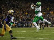 SEATTLE, WA - OCTOBER 17:  Wide receiver Kirk Merritt #11 of the Oregon Ducks makes a catch against defensive back Kevin King #20 of the Washington Huskies on October 17, 2015 at Husky Stadium in Seattle, Washington. The Ducks defeated the Huskies 26-20 .  (Photo by Otto Greule Jr/Getty Images)