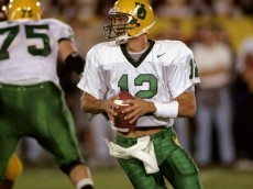 25 Oct 1997: Jason Maas #12 of the Oregon Ducks runs back to pass as teammate David Weber #75 blocks during the game against the USC Trojans at Los Angeles Coliseum in Los Angeles, California. USC defeated Oregon 22-24. Mandatory Credit: Elsa Hasch  /Allsport