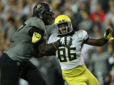 BOULDER, CO - OCTOBER 03:  Torrodney Prevot #86 of the Oregon Ducks battles against the block of Stephane Nembot #77 of the Colorado Buffaloes at Folsom Field on October 3, 2015 in Boulder, Colorado. The Ducks defeated the Buffs 41-24.  (Photo by Doug Pensinger/Getty Images)