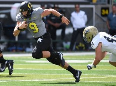 EUGENE, OR - SEPTEMBER 3: Quarterback Dakota Prukop #9 of the Oregon Ducks runs past defensive back Zach Jones #44 of the UC Davis Aggies during the first half of the game at Autzen Stadium on September 3, 2016 in Eugene, Oregon. (Photo by Steve Dykes/Getty Images)