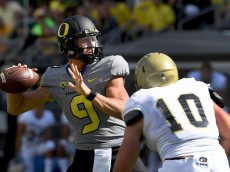 EUGENE, OR - SEPTEMBER 3: Quarterback Dakota Prukop #9 of the Oregon Ducks passes the ball as defensive lineman Brandon Weaver #10 of the UC Davis Aggies applies pressure sduring the first half of the game at Autzen Stadium on September 3, 2016 in Eugene, Oregon. (Photo by Steve Dykes/Getty Images)