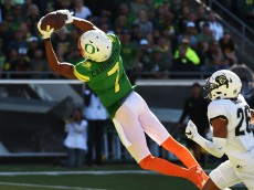 EUGENE, OR - SEPTEMBER 24: Wide receiver Darren Carrington II #7 of the Oregon Ducks catches a touchdown pass on defensive back Isaiah Oliver #26 of the Colorado Buffaloes during the second quarter of the game at Autzen Stadium on September 24, 2016 in Eugene, Oregon. (Photo by Steve Dykes/Getty Images)