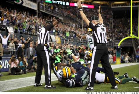 120925062348-nfl-replacement-refs-2-story-top