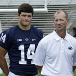 Penn St quarterbacks Tyler Ferguson (5) and Christian Hackenberg (14) pose with quarterbacks coach Charlie Fisher for a group photo during the NCAA college football team's media day in State College, Pa., Thursday, Aug. 8, 2013. (AP Photo/Gene J. Puskar)