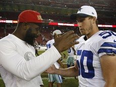 San Francisco 49ers linebacker NaVorro Bowman, left, greets Dallas Cowboys linebacker Sean Lee (50) after an NFL preseason football game in Santa Clara, Calif., Sunday, Aug. 23, 2015. (AP Photo/Tony Avelar)