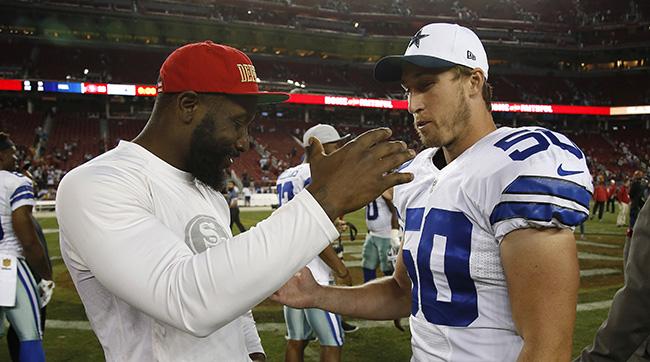 San Francisco 49ers linebacker NaVorro Bowman, left, greets Dallas Cowboys linebacker Sean Lee (50) after an NFL preseason football game in Santa Clara, Calif., Sunday, Aug. 23, 2015. (AP Photo/Tony Avelar)