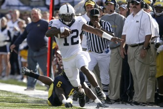 ANN ARBOR, MI - OCTOBER 15:  Michael Robinson #12 of Penn State gains yards along the sidelines against Michigan during the first quarter on October 15, 2005 at Michigan Stadium in Ann Arbor, Michigan.  (Photo by Tom Pidgeon/Getty Images)