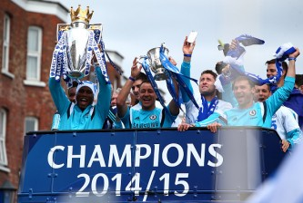 LONDON, ENGLAND - MAY 25: Didier Drogba and John Terry hold up the Premier League trophy and League Cup trophy as they exit the stadium during the Chelsea FC Premier League Victory Parade on May 25, 2015 in London, England, (Photo by Charlie Crowhurst/Getty Images)