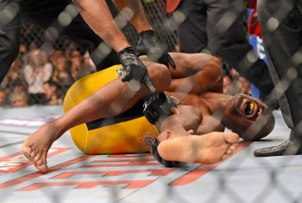 Anderson Silva lies in pain grabbing his broken leg at UFC 168 against Chris Weidman