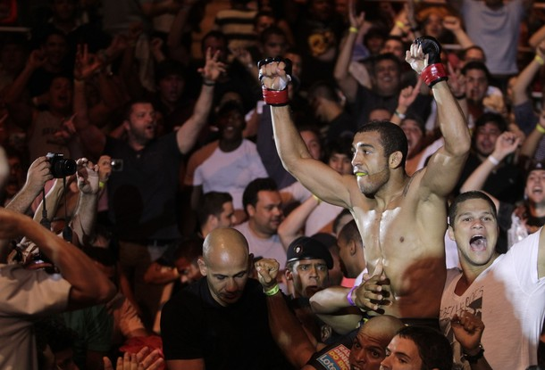 jose aldo celebrating in crowd at ufc 142