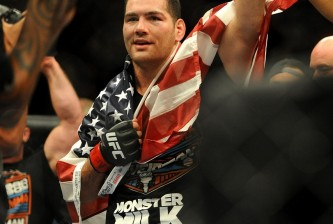 chris weidman with american flag celebrating ufc 175 victory over lyoto machida