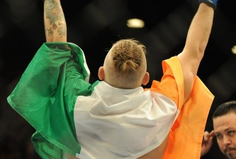 conor mcgregor celebrates ufc 178 win with irish flag
